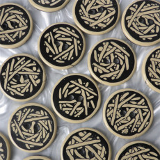 large round black and ivory buttons